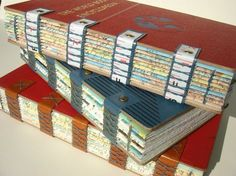 Hand bound journals. Recycled from old encyclopedias.