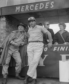 Juan Manuel Fangio talking to Mercedes team member Karl Kling | Formula 1 photos | ESPN F1 1954