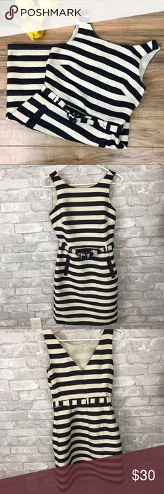 """Banana Republic Heritage Nautical Dress Size 0 Very good used condition navy and cream striped dress perfect for spring and summer. Features cute matching belt, size zipper, and V back neckline. Ladies, this one has pockets!! Measurements: Pit to pit 17""""; Waist 14""""; Hip 18.5""""; Length 33.5"""". Material 100% polyester. Tends to pull with use (easily removed with fabric shaver). Dry clean. Banana Republic Dresses"""