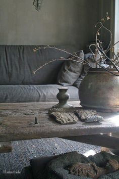 Moody colours and lighting, lots of texture and natural materials