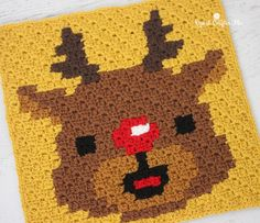 Rudolph Pixel Square by Repeat Crafter Me. Crochet this fun pixel square on its own or as part of a Christmas Afghan! Make it with Vanna's Choice in yellow, 3 shades of brown, black and of course RED and a size F crochet hook! Filet Crochet, Crochet Afghans, Crochet Diy, Ravelry Crochet, Crochet Square Patterns, Crochet Squares, Crochet Blanket Patterns, Baby Blanket Crochet, Afghan Patterns