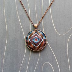 Southwest Sun Cross stitch pendant necklace by TheWerkShoppe, $34.00