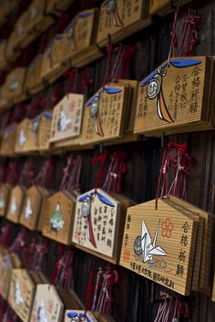 Ema 絵馬 - small wooden plaques on which Shinto worshippers write their prayers or wishes in Japan.