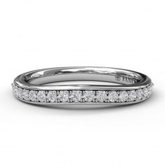 ($990) Fana curved wedding band - Matching wedding band to S3593. The wedding band contains 0.24 carat total weight of round brilliant cut diamonds. #curved #weddingband #weddingbands #fana #diamond