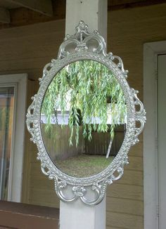 Ornate Oval Mirror in Vintage Metal Frame - 17 x 12 inch Handpainted Brass in Shiny Silver. $69.00, via Etsy.