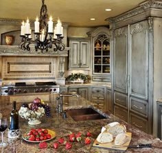 Old World style kitchen ~ more formal than I usually choose but pretty.