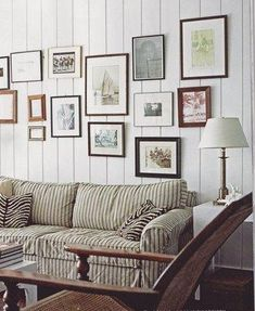 living rooms - striped sofa paneled walls eclectic art gallery  beach house living room  paneled walls, eclectic art gallery, striped sofa and