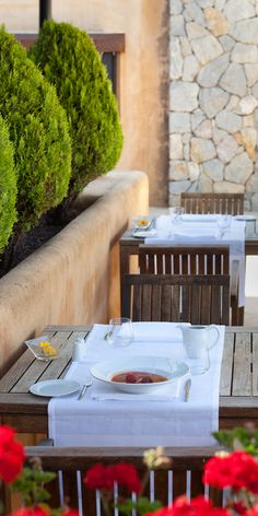 Outdoor dining area of the 3|65 restaurant in Mallorca - restaurant terrace at Son Brull Hotel & Spa, Pollensa, Spain