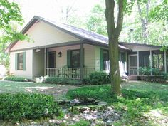 Cozy Cottage in the Woods along glorious Lakeshore Drive. Lake Michigan beach access and wifi. Quiet cottage in the woods with all the comforts of home provides a peaceful base from which to explore the Arts Coast ...