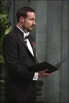 Crown Prince Haakon of Norway reading from the scriptures during the wedding ceremony in the Nidaros Cathedral; wedding of Princess Märtha Louise of Norway and mr. Ari Behn on May 24, 2002