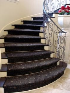 Zoroufy's Heritage® Collection stair rods in polished brass on a cruved staircase. The installation was done by Classic Design Floor To Ceiling in Lodi, CA.