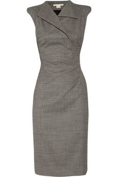ANTONIO BERARDI Sharp-shouldered stretch-wool dress. black and white stretch-wool, padded shoulders, cap sleeves, exaggerated lapels, fully lined. Zip and snap fastenings at front; zip fastening at side. $1,705