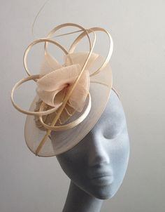 Taupe Beaded Fascinator with Curled Ostrich Spine and Crinoline Edge.. £105.00, via Etsy.