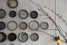 Instead of vintage pie plates - you could use the inside of paint can lids w/ different colored paints dried on them!