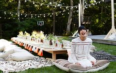 low, 50-foot-long plywood table dressed simply with a craft paper runner
