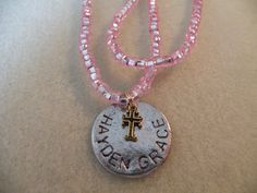 Personalized hand stamped name with mini cross charm.......Abba Dabba Beads