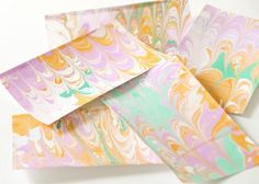 DIY marbled notecards tutorial (using simple ingredients & acrylic paint) from House of Earnest - this is so pretty!