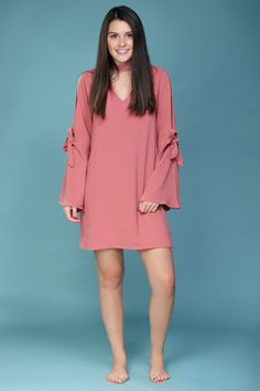 Pretty coral-pink dress with bell sleeves. So cute with booties now and makes a great early spring dress.