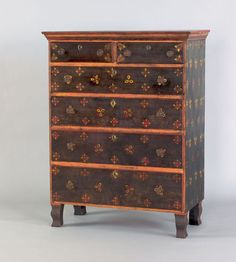"Mahantongo Valley, Pennsylvania painted semi tall chest, ca. 1830, retaining a later potato stamp decoration on the original green sponge decorated ground, 55"" h., 39 1/2"" w."