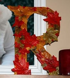Use cardboard to cut out a letter then glue leaves to it.  Why didn't I think of…