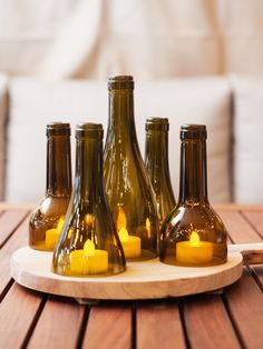 Illuminate your outdoor dining space with these Wine Bottle Tealight Domes by Ale & Vine. These glass wine bottle necks come in various heights, arranged on a vineyard wooden tray for a natural, rustic feel. Add your own tealights for a warm subtle glow. Wine Bottle Vases, Wine Bottle Centerpieces, Lighted Wine Bottles, Diy Bottle, Bottle Lights, Bottle Art, Glass Bottles, Wine Glass, Wine Bottle Windchimes