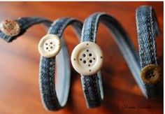 Bracelets.. Cut it out about 30 cm from the side seam of your jeans. Thread a wire in the seam and finish the edges. Use nice trinkets to decorate them. You can use a glass to help you give the round shape to your bracelet!