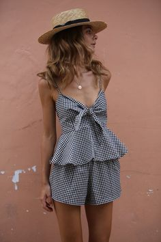girl wearing cute ruffle gingham jumpsuit summer outfit idea