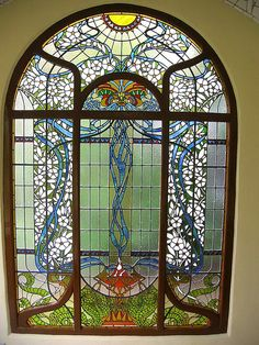 Beautiful - this whole structure is amazing!  Just a garden house full of stained glass.