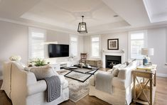 The Long Island- Oswald Homes. I like the touches of black to anchor the room and keep it from being too airy and light. Hamptons Living Room, Coastal Living Rooms, Living Room Interior, Home Living Room, Hamptons Kitchen, Coastal Cottage, Living Spaces, Hamptons Style Decor, The Hamptons