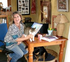 Chantelle with Dinky (da kitty) and Ruffian (da Rottie) in our home studio.