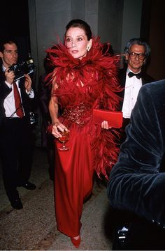 Audrey Hepburn, 1989 stands out in red feathers