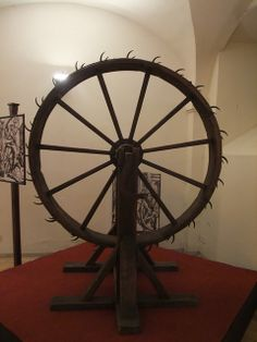 Torture Wheel--Reserved for hated criminals, the victims were tied to the spokes. The torturer would then rotate the wheel while hitting the victim with an iron rod.