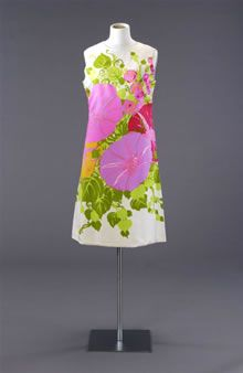 Image: Sleeveless shift-style dress with high scoop neck, made of white silk printed in green, pink, orange and red in a design with big convolvulus flowers (pink, red and orange) and green tendrils and leaves. The design is rather like a painting on a canvas rather than an all-over design, with the green foliage as both a background and framing the single big colourful flowers. (picture: Mandy Reynolds)
