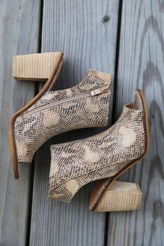 Chic open-toe wedge with exposed heel and peep toe! - Interior side zipper - Fits true to size - 4'' wood heel with slip resistant outsole - Suede/Leather Upper - Snakeskin print - Man-Made outsole
