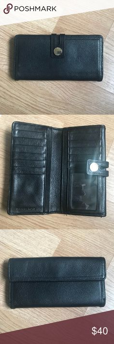 Michael Kors Wallet Black leather Michael Kors Wallet  Minor scuffing of Front Metal clasp Gently used in good condition   Please Note No modeling, no trades, no transactions off of Posh.  Thanks for checking out my closet. Michael Kors Bags Wallets