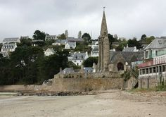 Many happy memories in Saint-Michel-en-Greve visiting my Grandparents house that you can just see behind the church on the hill!   travel photo | Brodyaga.com image gallery: France, Bretagne