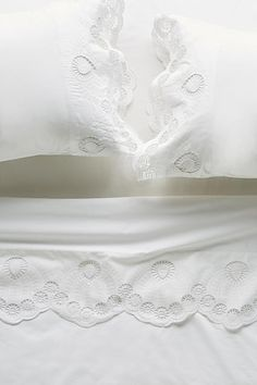 Embroidered eyelet sheets for the perfect women. Super white, clean, and fresh finish  | repinned by Five Queens Court