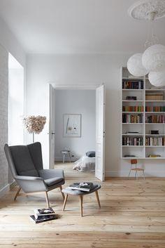 INTERIOR DESIGNER & STYLIST: Agnieszka Suchora / PHOTOGRAPHY & POSTPRODUCTION: Jola Skóra // ceiling lamp: IKEA / floor lamp: BAZUR proj. Karina Królak & Patka Smirnow / armchair with footstool: BoConcept / small stool: Modernizm Design / night table in bedroom: Muuto / NAP / transparent: Avocado, proj. T. A. Rudkiewicz | TAR / bedspread and pillow: NAP / painting: Andrzej Dud