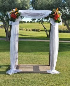 Wedding Ceremony arch with tropical floral decor by Enchanted Florist Las Vegas