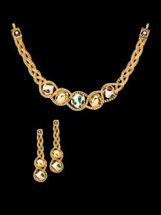 Beni-Ball - Innovations  Mughal inlays are simulated using heavy enamelling in the graduated gold globes held together with v-chain plats. This flexible little necklace can also be worn as a choker, wristlet or armlet.