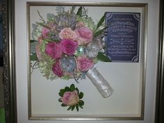 preserved bridal bouquet of mixed flowers and succulents, in shadow box with boutonniere and invitation.