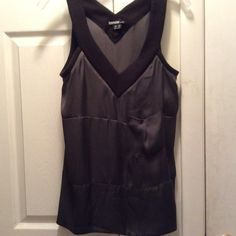 Kenzie silky dark gray top X-small, but fits like a s-m. Silky body with knit straps and a cool front pocket. Very unique and comfy. Dress up or down. Worn once. kenzie Tops