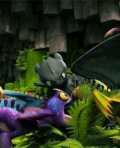 Gif of Toothless being overwhelmed by baby dragons.