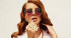 "Singer Lana del Rey has described herself as ""Lolita got lost in the hood"" and the ""ghetto Nancy Sinatra."" Hence the sunglasses—a reference to the 1962 Stanley Kubrick film of Vladimir Nabokov's novel—coupled with a knuckle ring.  Born Elizabeth Woolridge Grant, Lana del Rey has said of her pseudonym: ""I wanted a name I could shape the music towards […] I was going to Miami quite a lot at the time, speaking a lot of Spanish with my friends fro"