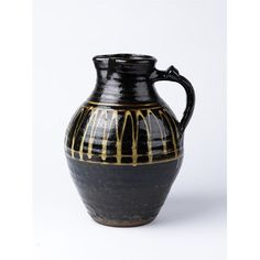 Jug  Place of origin: Winchcombe, England (made)  Date: 1938 (made)  Artist/Maker: Cardew, Michael, born 1901 - died 1983 (maker)  Winchcombe Pottery (maker)  Materials and Techniques: Earthenware, with slip-trailed decoration in white on black