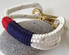 White and Gold Nautical Rope Bracelet with Navy & Red by Buoy6. $19.95 USD, via Etsy.