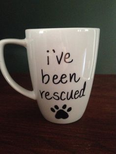Ive been Rescued Dog Paw Coffee Cup All coffee mugs are made to order. I use an oil-based paint, let it dry, cure it in the oven, then