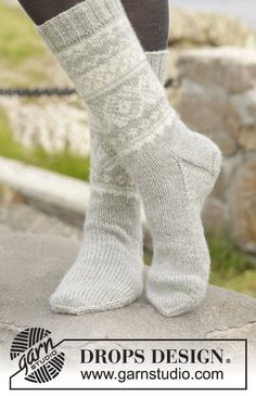 "Silver Dream Socks - Knitted DROPS socks with Norwegian pattern in ""Karisma"". Size 35 to 46 - Free pattern by DROPS Design Knitted Boot Cuffs, Knitted Slippers, Knit Mittens, Knitting Socks, Wool Socks, Knitting Patterns Free, Free Knitting, Crochet Patterns, Free Pattern"