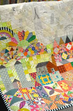 Close up of it's a small world quilt