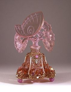 """fawnvelveteen: """"1920s perfume bottle and stopper in pink crystal with enamel and jeweled metalwork, glass feet, dauber stub. Czech mark on metal. 6 7/8 in. Sold for $4000 in 2009"""""""